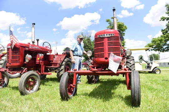 Paul Hartschuh, of Sycamore, admires a Farmall A during the Crawford Farm Machinery Show.