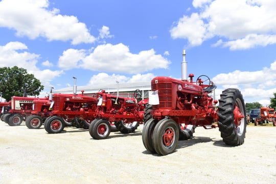 A row of Farmalls was on display during the 2019 Crawford Farm Machinery Show.