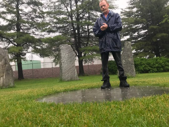 David Brizendine, former president of Circles for Peace, which implemented the Burlington Earth Clock, stands on its sundial in the center of the stone circle. June 20, 2019.