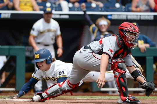 Jun 21, 2019; Omaha, NE, USA; Michigan Wolverines outfielder Jesse Franklin (7) slides home ahead of a tag from Texas Tech Red Raiders catcher Braxton Fulford (26) in the first inning in the 2019 College World Series at TD Ameritrade Park. Mandatory Credit: Steven Branscombe-USA TODAY Sports