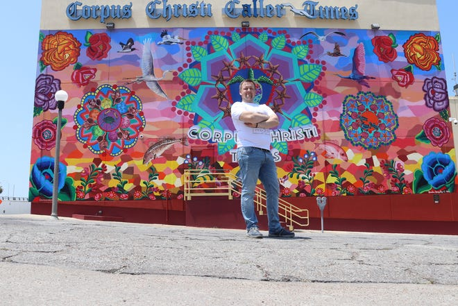 Pavel Alekseev, a journalist visiting the U.S. from Russia, stands in front of the  Corpus Christi Caller Times building.