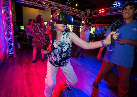 Visitors try out the new virtual reality gaming arcade at Waves Resort Corpus Christi on Thursday, June 20, 2019.