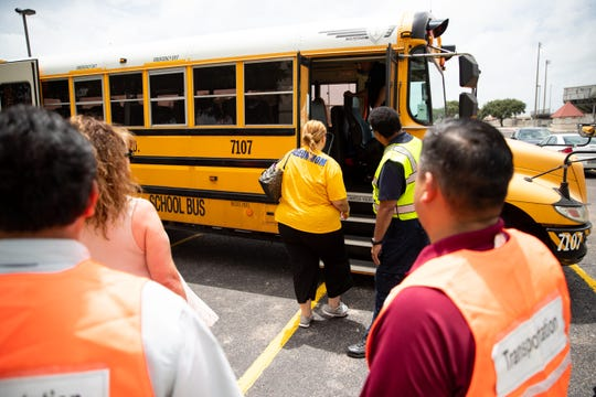 Evacuees are loaded on to buses as the city of Corpus Christi, Texas Department of Emergency Management and other agencies conduct a hurricane evacuation drill at the Cabaniss natatorium on Friday, June 21, 2019.