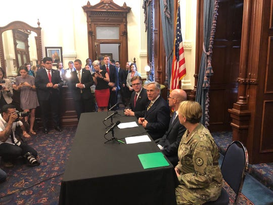 Gov. Greg Abbott, second from left, at a news conference on border security in the Texas Capitol, June 21, 2019.