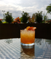 The Harvest Peach Bourbon  features Basil Hayden Bourbon, white peach puree, organic agave nectar and soda, perfect to pair with a summer meal at Harvest Seasonal Grill & Wine Bar in Moorestown.