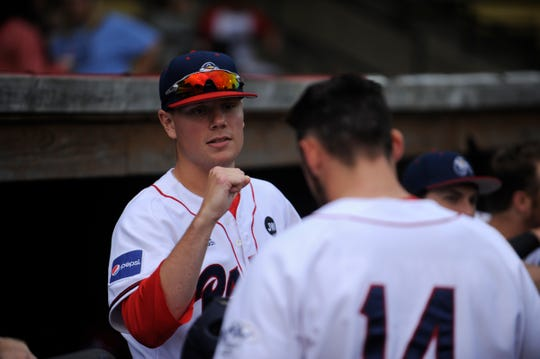 Chillicothe Paints pitcher Taylor Perrett fist bumps teammate in a 4-2 win over Terre Haute on June 20. The Paints fell to Terre Haute 6-5 on Friday despite Perrett's seven inning, no-hit start.