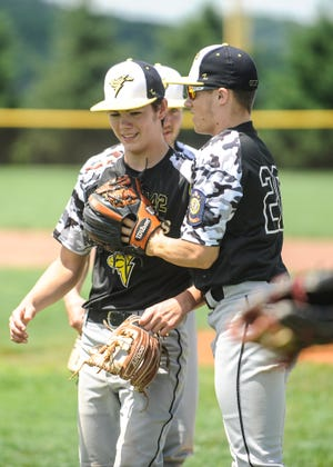 Weston Roop and Ian Gillen celebrate after an 11-1 win over Hillsboro Post 129 on July 21, 2019. The Waverly Post 142 Shockers finished as the Jadwin Memorial Tournament runners-up on Sunday.