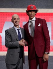 NBA Commissioner Adam Silver poses for photographs with Texas' Jaxson Hayes after the Atlanta Hawks selected him as the eighth overall pick in the NBA basketball draft Thursday, June 20, 2019, in New York.