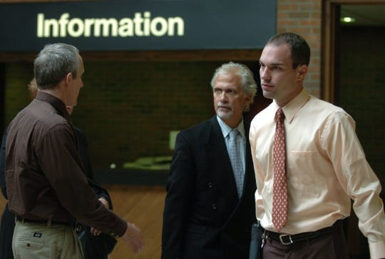 WIDMER  OCTOBER 22, 2008      Ryan Widmer leaves the Warren County courthouse after talking to his lawyer Charlie Rittgers, in background, on Wednesday, October 22, 2008.   Lawyers met with the judge today and made decisions on evidence in the murder case against Widmer.  The Enquirer/Leigh Taylor