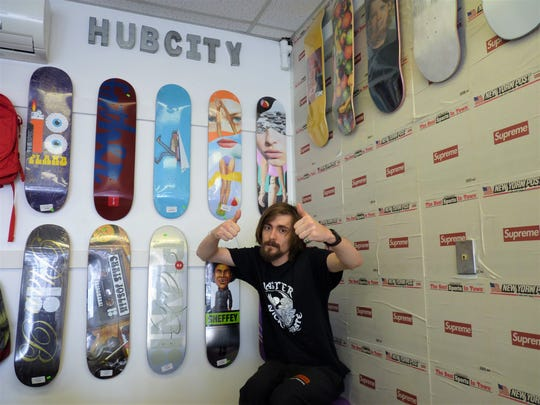 Alexander D. Patakos, owner of Hub City Skates, inside his recently-opened skateboard and vintage clothing resale shop on South Bridge Street in Somerville.