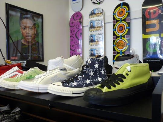 Shoes and skateboards for sale and on display at Hub City Skates in Somerville.
