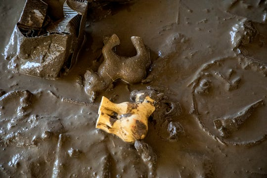 A detail shot of My Little Ponies found in the mud at Wilson McCoy's home after his basement flooded during the heavy rains this week.