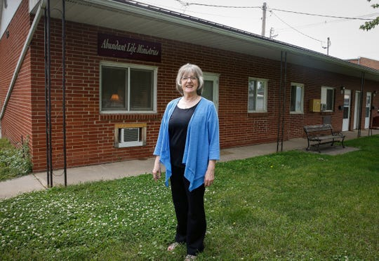 Victoria Fink poses for a photo outside of Abundant Life Ministries in Vinton on Tuesday, June 18, 2019.