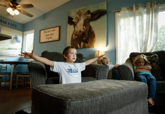 Brody Rhoades, 9, describes the night in 2018 when the family's house exploded after they escaped a flash flood. Since then, the Rhoades family has relocated to a new home in Urbandale, but the lingering fears of severe weather exist, prompting anxiety during heavy storms.