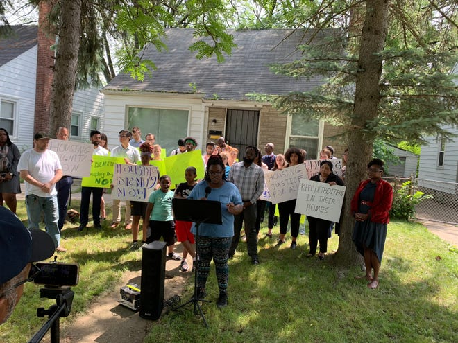 Detroiter Sabrina Beal, who lost one home to foreclosure, speaking on June 19 at her new home.