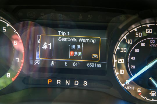 A new feature that alerts the driver which seat belt is unhooked on the dashboard of the 2019 Ford Ranger Supercrew cab photographed in Southfield, Michigan, on Friday, June 21, 2019.