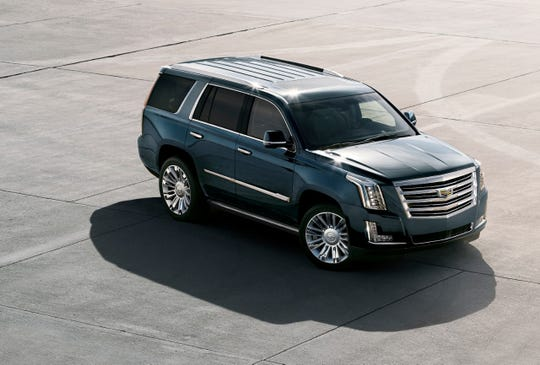 Automakers can charge a premium for SUVs, such as the Cadillac Escalade.
