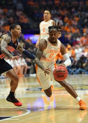 Tennessee's Jordan Bone drives against Auburn's J'Von McCormick during the SEC conference tournament championship game March 17, 2019.