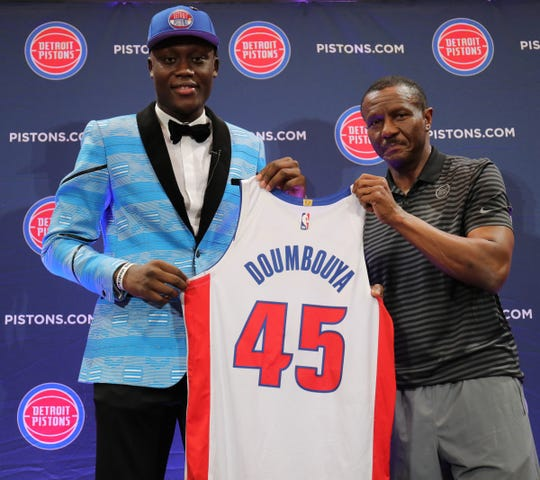 Dwane Casey with Pistons first-round draft pick Sekou Doumbouya on Friday in Auburn Hills.