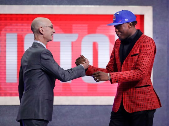 Sekou Doumbouya greets NBA commissioner Adam Silver after being selected as the 15th overall pick to the Detroit Pistons in the first round of the NBA draft at Barclays Center, June 20, 2019 in Brooklyn, N.Y.