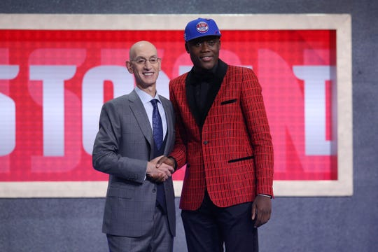 Sekou Doumbouya greets NBA commissioner Adam Silver after being selected by the Pistons in the first round at Barclays Center.