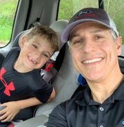 Kevin Koshkarian says the new seatbelt technology helps him as  parent monitor his son when he's in the backseat. This photo was taken on May 18, 2019 in Milford.