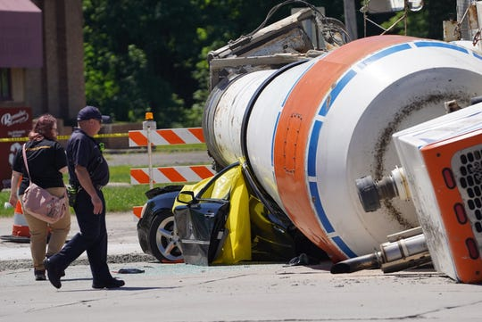 Woman dies when cement truck rolls on top of car in Romulus