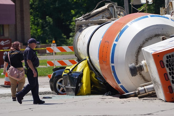 A scene where a driver was killed after a cement truck rolled over onto the vehicle at the intersection of Van Born and Merriman in Romulus on Friday, June 21, 2019.