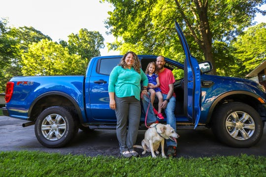 Beth Kanous, 37, her husband Daniel Long, 38, their daughter Alice Long, 5, and Sasha the dog use the 2019 Ford Ranger Supercrew cab as their family car, photographed in Southfield, Mich. on Friday, June 21, 2019.