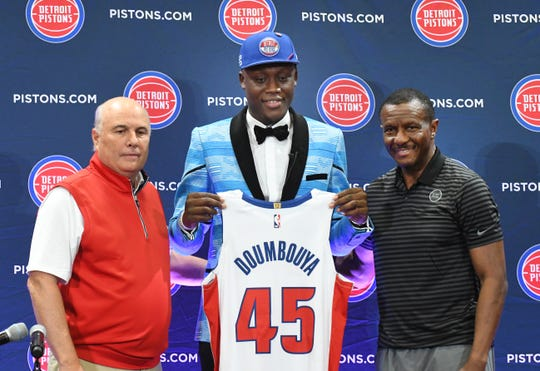 Ed Stefanski, left, and Dwane Casey welcome new Pistons first-round draft pick Sekou Doumbouya on Friday.