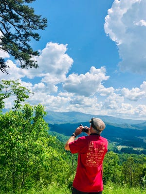 A birdwatcher on the newly-completed Foothills Parkway in Great Smoky Mountains National Park.