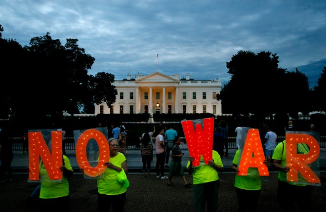 "Protesters outside the White House, Thursday June 20, 2019, in Washington, after President Donald Trump tweeted that ""Iran made a very big mistake"" by shooting down a U.S. surveillance drone over the Strait of Hormuz in Iran."