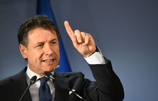 Italian Prime Minister Giuseppe Conte speaks during a media conference at the end of an EU summit in Brussels, Friday, June 21, 2019. EU leaders concluded a two-day summit on Friday in which they discussed, among other issues, the euro-area.