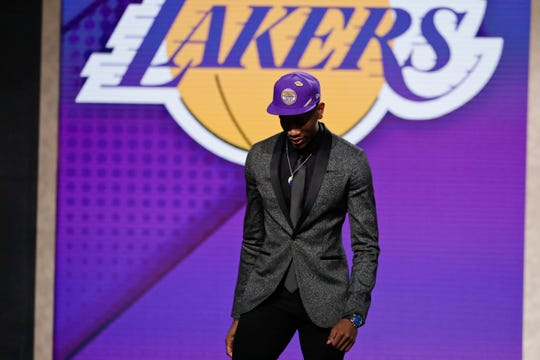 De'Andre Hunter, of Virginia, leaves the stage after being selected with the fourth pick overall by the Los Angeles Lakers.Hunter was taken fourth by the Los Angeles Lakers in a pick they had already agreed to trade to the New Orleans Pelicans to acquire Anthony Davis. That deal can't officially go through until July 6.