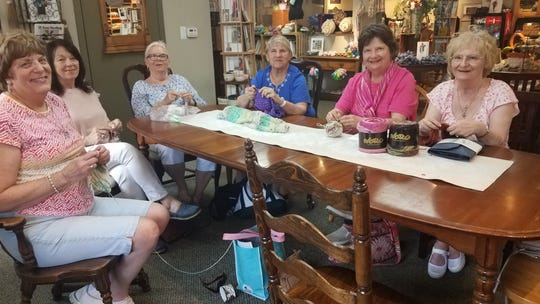 While on their two-day 'yarn crawl' along I-75, close friends, from left, Joyce Ford, Mierial Gage, Betty Robinson, Pat Sabedra, Sue Paige and Elaine Ouellette knit at Ewe-nique Knits in Royal Oak.