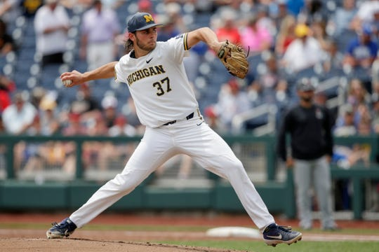 Michigan starting pitcher Karl Kauffmann works against Texas Tech in the first inning.