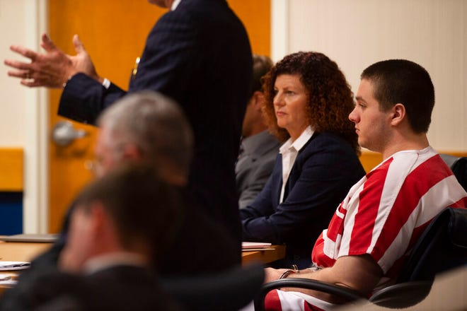 Austin Harrouff, right, who is accused of killing a Tequesta couple in 2016, listens as his attorney Robert Watson the court during a hearing Thursday, June 13, 2019, at the Martin County Courthouse in Stuart, Fla.