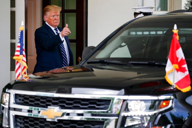 President Donald Trump makes the thumbs up sign to Canadian Prime Minister Justin Trudeau as he leaves the West Wing of the White House, Thursday June 20, 2019, after their meeting in Washington.