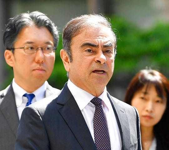 Former Nissan chairman Carlos Ghosn, center.