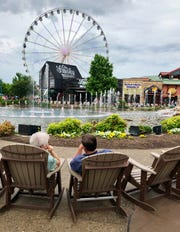 Visitors pause and sit a spell in Pigeon Forge.