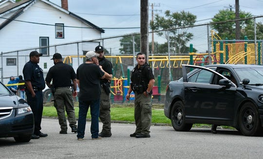 Detroit police gather on Honorah Street in Detroit during an investigation of a fatal shooting. A teen was shot during an exchange between the teen and suspect, who was fatally shot Thursday evening.