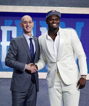 Duke's Zion Williamson, right, poses for photographs with NBA Commissioner Adam Silver after being selected by the New Orleans Pelicans with the first pick in the NBA Draft Thursday.