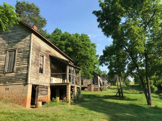 """When """"The Hunger Games"""" was filmed in North Carolina in 2011, the mill village served as the home of Katniss, Peeta and Gale."""