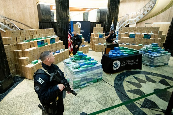 Officers stand guard over a fraction of the cocaine sized from a ship at a Philadelphia port