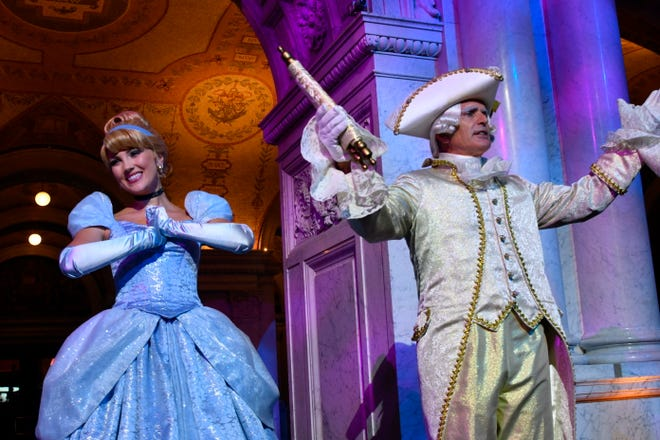 """Costumed Cinderella and Majordomo appear before guests at an event marking the inclusion of Disney's """"Cinderella"""" into the National Film Registry on its 70th anniversary, Thursday night at the Library of Congress in Washington."""