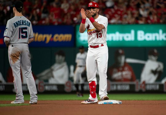 St. Louis Cardinals' Matt Carpenter, right, celebrates a bunt double as he stands on second base in front of Miami Marlins third baseman Brian Anderson, left, during the fifth inning of a baseball game Monday, June 17, 2019, in St. Louis. (AP Photo/L.G. Patterson)