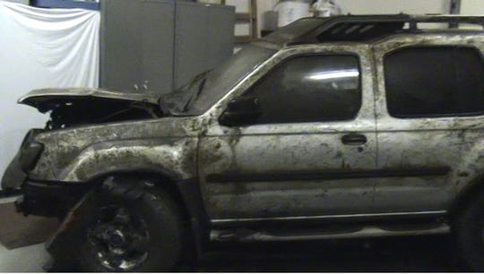 Kristy Kelley's vehicle in storage after the Warrick County Sheriff's Office removed it from the lake where it was submerged.