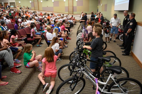 Students on edge waiting to see if they will get a bicycle at the 14th annual bike give away for middle and elementary school students participating in the Ivy Tech Community College Public Safety Academy Thursday, June 20, 2019.
