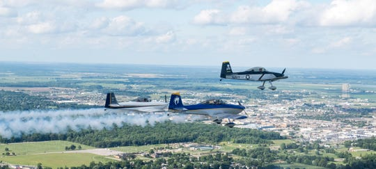 Members of the Rocky Mountain Renegades air show team soar over Evansville, Ind. during a practice for the 2019 ShrinersFest Thursday, June 20, 2019.