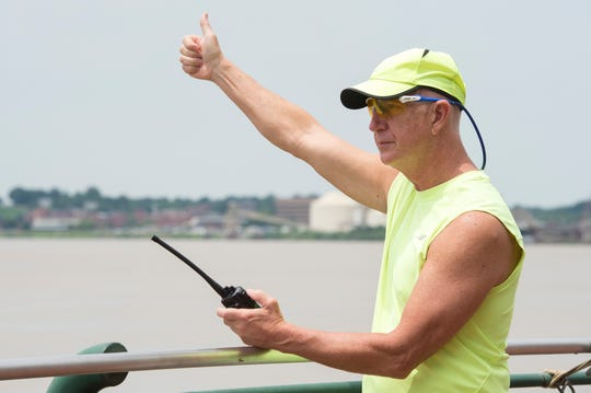 Air Boss Jon Pawelkop signals with a thumbs up to the pilot of a Republic RC-3 Seabee during the 2019 ShrinersFest air show rehearsal Friday, June 21, 2019.